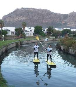 Guy Bubb and Glen Thompson paddling the Steenberg Canal, above Zandvlei, 2011 Peninsula Paddle